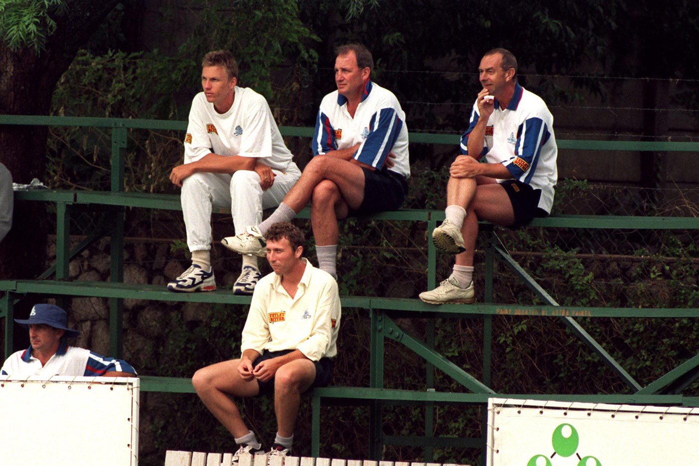 Mullally (far left, top) with fellow fishing aficionados Atherton (centre, below) and Lloyd (far right) on the sidelines of a Bulawayo tour match in 1996