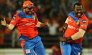Dwayne Smith and Suresh Raina in a mid-pitch jig after dismissing Steven Smith, Gujarat Lions v Rising Pune Supergiant, IPL, Rajkot, April 14, 2017