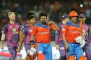 Suresh Raina and Aaron Finch walk back after competing a win for Gujarat Lions, Gujarat Lions v Rising Pune Supergiant, IPL 2017, Rajkot, April 14, 2017