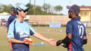 Coach Beau Casson shares bowling advice with USA left-arm spinner Prashanth Nair, Pearland, April 6, 2017