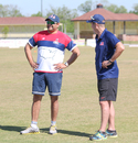 Former USA captain Sushil Nadkarni chats with fielding coach Trevor Penney, Pearland, April 7, 2017