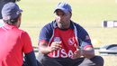 USA U-19 coach Thiru Kumaran discusses bowling strategy with Ali Khan, Pearland, April 7, 2017