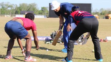 Wicketkeeping guru Peter Anderson puts USA keepers Akeem Dodson and Ibrahim Khaleel through a golf ball catching drill