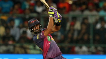 Manoj Tiwary holds the pose after hitting a straight six