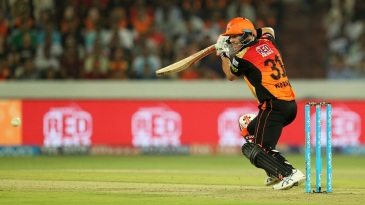 David Warner opens the face of his bat to steer one