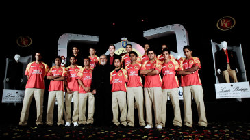 The Bangalore Royal Challengers line up with team owner Vijay Mallya (in black)