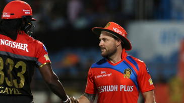 Chris Gayle and Brendon McCullum shake hands after the latter's floppy hat handed the Jamaican a reprieve