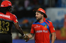 Chris Gayle and Brendon McCullum shake hands after the latter's floppy hat handed the Jamaican a reprieve, Royal Challengers Bangalore v Gujarat Lions, Rajkot, IPL 2017, April 18, 2017