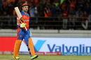 Brendon McCullum raises his bat after notching up his half-century, Royal Challengers Bangalore v Gujarat Lions, Rajkot, IPL 2017, April 18, 2017