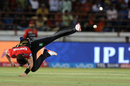 Adam Milne puts in an acrobatic effort while having a shy at the stumps, Royal Challengers Bangalore v Gujarat Lions, Rajkot, IPL 2017, April 18, 2017