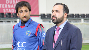 Afghanistan Cricket Board chairman Atif Mashal stands with captain Asghar Stanikzai ahead of the ceremony for Nawroz Mangal