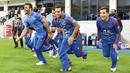 Afghanistan players sprint toward the middle after the winning runs, Afghanistan v Ireland, Desert T20, Final, Dubai, January 20, 2017