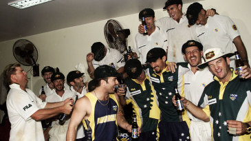 Australia celebrate their win with beers