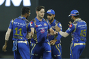 Mitchell McClenaghan celebrates the wicket of Shaun Marsh with his team-mates, Mumbai Indians v Kings XI Punjab, IPL 2017, Indore, April 20, 2017