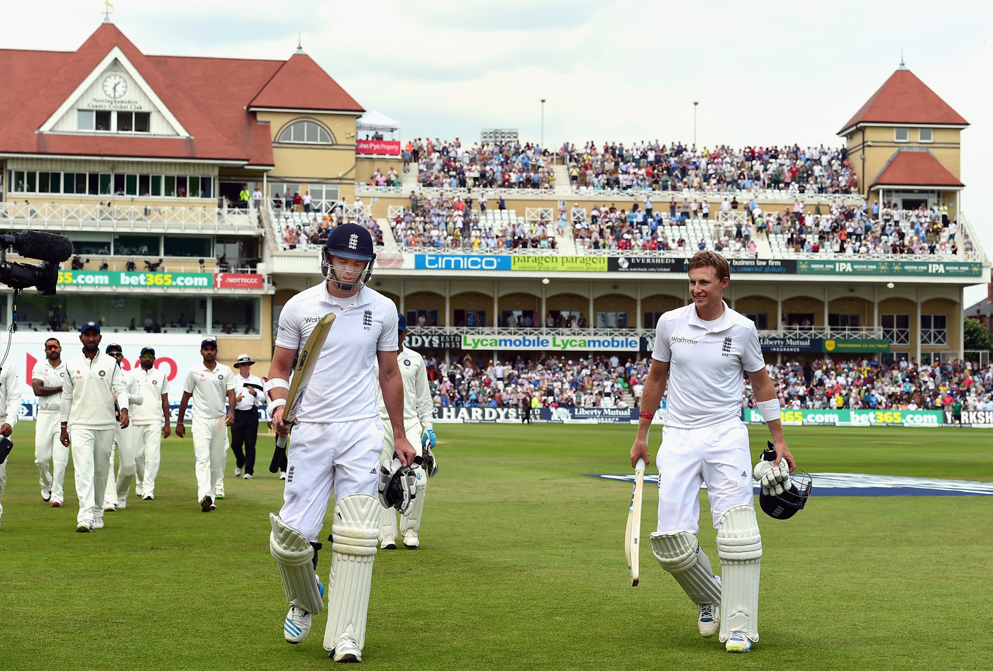 James Anderson and Joe Root walk off for a well-earned lunch