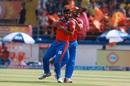 Suresh Raina congratulates Nathu Singh after Manan Vohra's dismissal, Gujarat Lions v Kings XI Punjab, IPL 2017, Rajkot, April 23, 2017