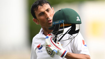 Younis Khan kisses his helmet after reaching the landmark