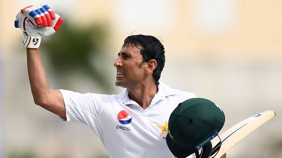 Younis Khan punches the air on reaching 10,000 runs