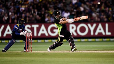 Aaron Finch hits a six
