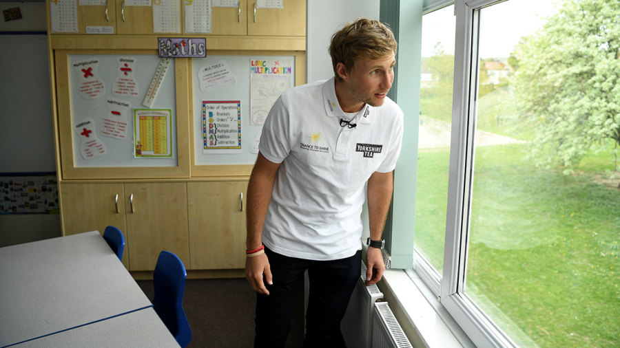 Joe Root looks of out the classroom window at his old school, Dore Primary School,