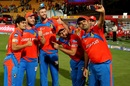 Gujarat Lions players pose for pictures after their win, Royal Challengers Bangalore v Gujarat Lions, IPL 2017, Bengaluru, April 27, 2017