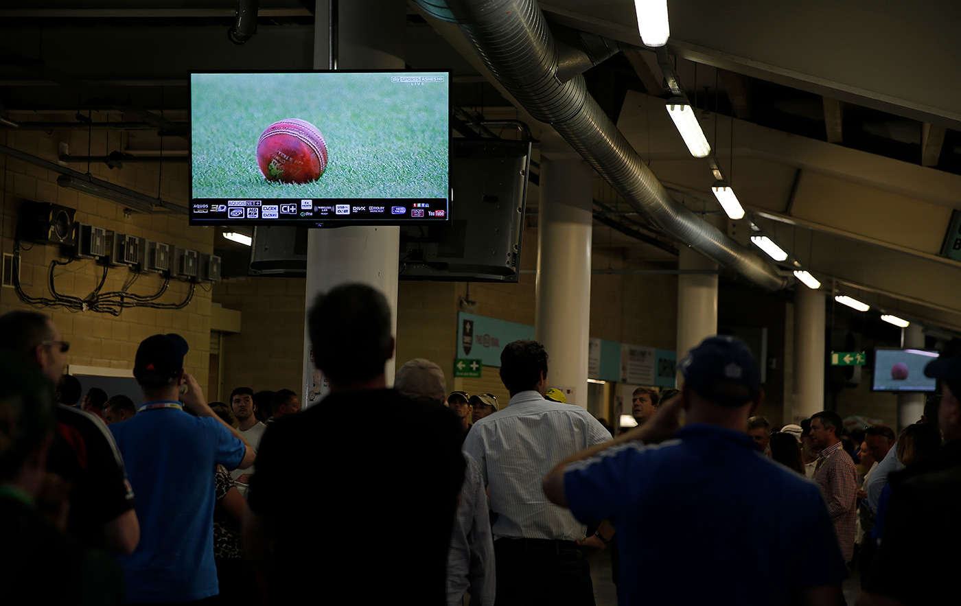 People watch the match on a large screen