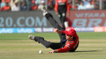 Travis Head embraces the floor while fielding