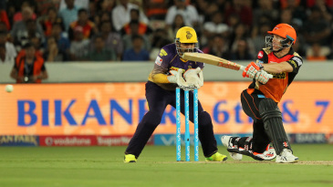 David Warner sweeps during his quickfire knock
