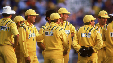 The Australians come together after a wicket