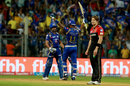 A dejected Shane Watson looks on as Rohit Sharma and Hardik Pandya celebrate the victory, Mumbai Indians v Royal Challengers Bangalore, IPL 2017, Mumbai, May 1, 2017