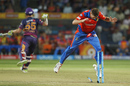 James Faulkner lets the ball hit the stumps during Rahul Tripathi's run out with a livid Ben Stokes in the background, Rising Pune Supergiant v Gujarat Lions, IPL 2017, Pune, May 1, 2017