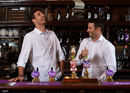 Steven Finn and Tim Murtagh pull pints during a Royal London promotional event, May 1, 2017
