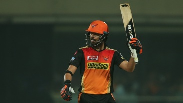 Yuvraj Singh raises his bat after reaching his 25th fifty in T20 cricket