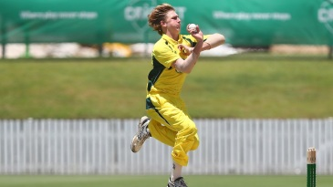 Will Sutherland runs in to bowl