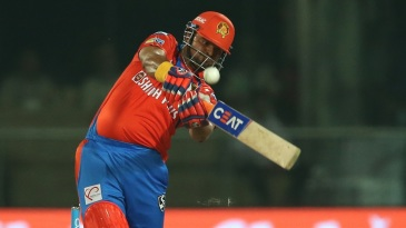 Suresh Raina muscles the ball over the infield for a boundary