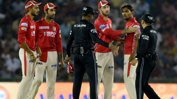 Glenn Maxwell tries to calm Sandeep Sharma down after the umpire made a contentious no-ball call