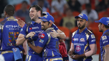Mitchell McClenaghan gets a hug from captain Rohit Sharma on dismissing David Warner