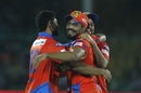 Ravindra Jadeja is congratulated by Suresh Raina and Basil Thampi after his direct-hit dismissed Corey Anderson, Gujarat Lions v Delhi Daredevils, IPL 2017, Kanpur, May 10, 2017