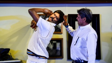 Kapil Dev admires his likeness at the Delhi launch of a Madame Tussauds museum