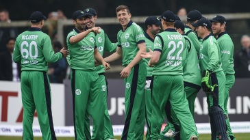Ireland's players get together to celebrate a wicket