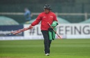 Umpire Ian Gould walks off with the stumps after rain interrupts play, Ireland v Bangladesh, tri-nation series, Malahide, May 12, 2017
