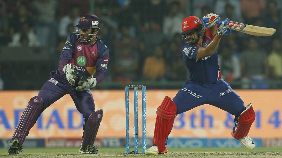 Karun Nair backs away and opens the face of his bat