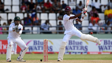 Roston Chase displays unorthodox footwork while slapping one through the off side