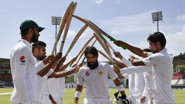 Misbah-ul-Haq walks out to a guard of honour after being dismissed for the final time