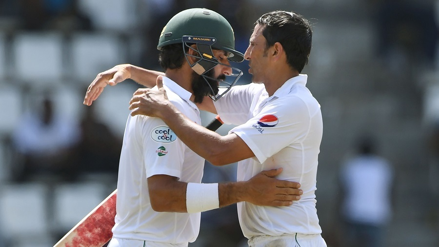 Misbah-ul-Haq is pulled into an embrace by team-mate Younis Khan after being dismissed in his final Test innings