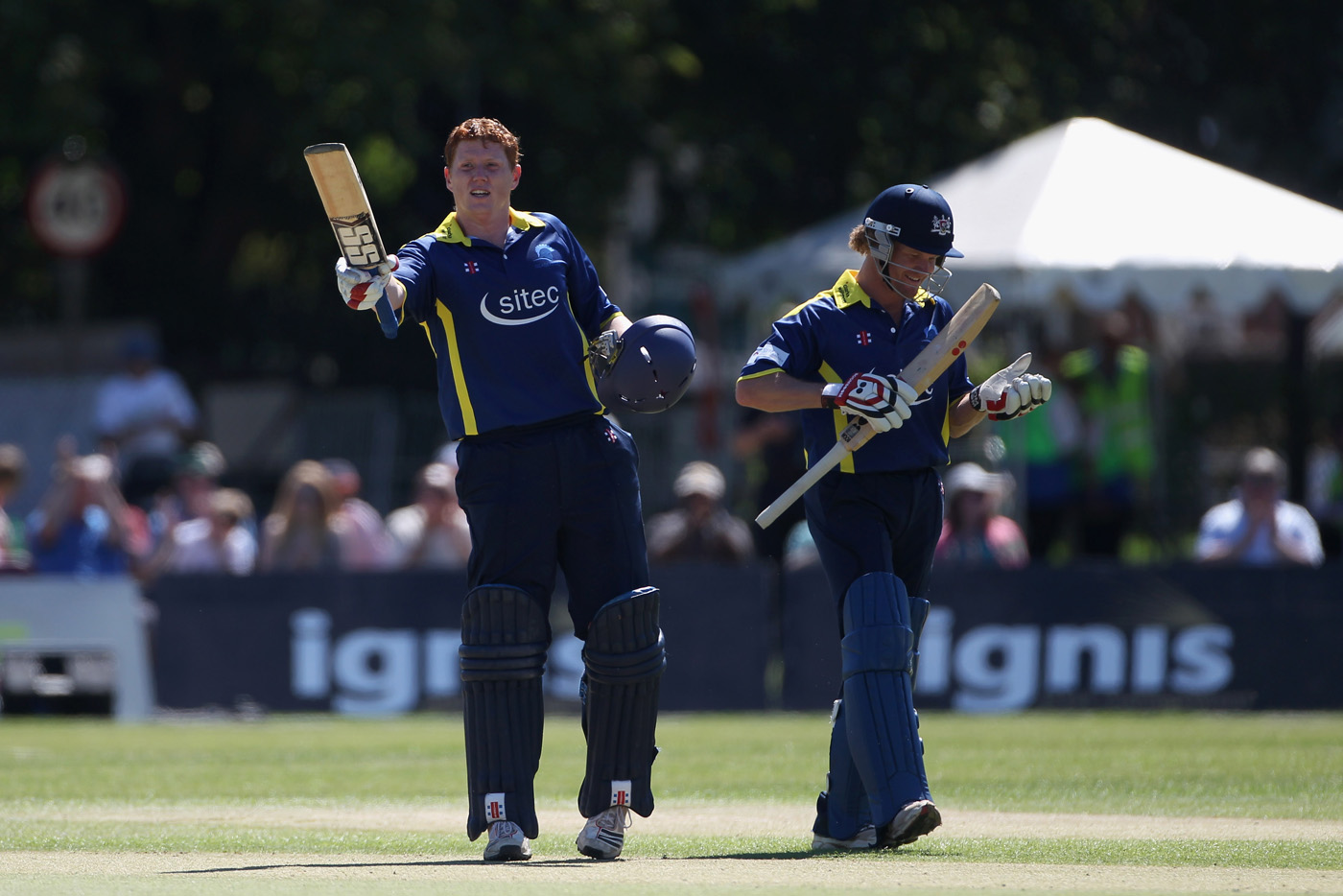 A penchant for clobbering 'em: Kevin O'Brien raises his bat after a 44-ball hundred