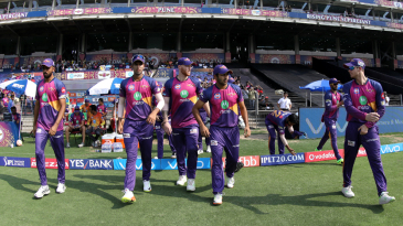 Rising Pune Supergiant players walk out to the field