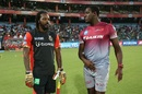 Chris Gayle catches up with his West Indies team-mate Carlos Brathwaite, Delhi Daredevils v Royal Challengers Bangalore, IPL 2017, Delhi, May 14, 2017
