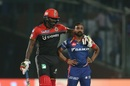 The long and short of it: Chris Gayle consoles Amit Mishra after an lbw appeal was turned down, Delhi Daredevils v Royal Challengers Bangalore, IPL 2017, Delhi, May 14, 2017