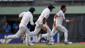 Yasir Shah celebrates the final wicket of the West Indies innings with his team-mates